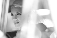 Black and white portrait of a beautiful woman in a car Royalty Free Stock Photography