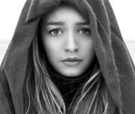 Black and white portrait of a beautiful young girl with big eyes with a sad mood, sadness on her face with a scarf on her head Royalty Free Stock Images
