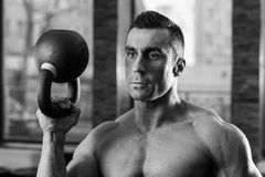 Black and white portrait of a bodybuilder holding kettle ball Royalty Free Stock Photos