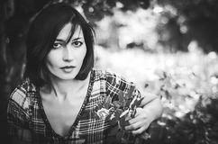 Black and white portrait of brunette in the garden stock photos