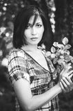 Black and white portrait of brunette in the garden royalty free stock photo