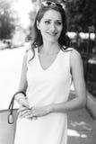 Black-and-white portrait of brunette woman in elegant dress Stock Image
