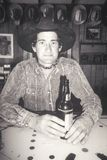 Black and White portrait of cowboy in bar with beer, Creston, CA Royalty Free Stock Image