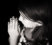 Black and white portrait of a cute girl praying Royalty Free Stock Photos
