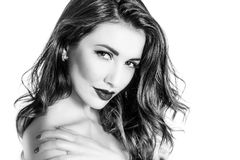 Black and white portrait of cute woman touching shoulder closeup Royalty Free Stock Image