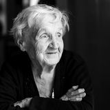 Black and white portrait of an elderly happy woman. Stock Photos