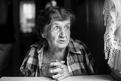 Black-and-white portrait of an elderly sad woman. Stock Image