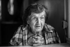 Black and white portrait of an elderly woman. Emotions. Stock Photo