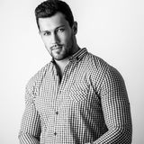 Black-white portrait of elegant sporty young handsome man in stylish shirt Stock Photos