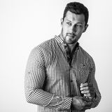 Black-white portrait of elegant sporty young handsome man in stylish shirt Royalty Free Stock Photography