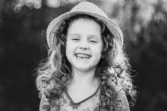 Black and white portrait of a funny little girl. Stock Photos