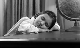Black and white portrait of girl fell asleep while doing homewor Royalty Free Stock Photo
