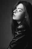 Black and white portrait of a girl. With glasses in studio Stock Images
