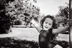 Black and white portrait happy child with hand up, enjoying free Royalty Free Stock Photography