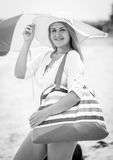 Black and white portrait of happy smiling woman posing on beach Stock Images