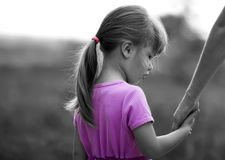 Black and white portrait of little girl holding a hand of her mo. Ther. Family relations concept royalty free stock images