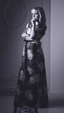Black and white portrait of lovely woman in dress Royalty Free Stock Image