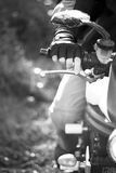 Black and white portrait of man on the bike. In park, close up stock images