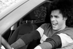 Black and white portrait of man getting into accident with car Royalty Free Stock Photos