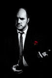 Black and white portrait of man, godfather-like character. Stock Photo