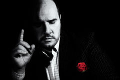 Black and white portrait of man, godfather-like character. Royalty Free Stock Photo