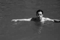 Black and white Portrait of a man in the pool Royalty Free Stock Photography