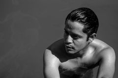 Black and white Portrait of a man in the pool Stock Images