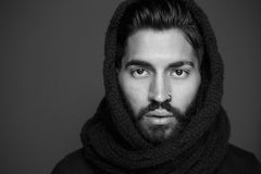 Black and white portrait of a man with wool scarf Royalty Free Stock Images