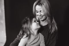 Black and white portrait of mother and daughter. Beautiful female. Little girl with mom royalty free stock photo