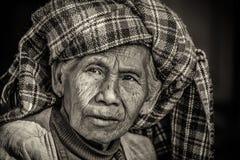 Black and white portrait of an old indigenous woman in Myanmar. PINDAYA, MYANMAR - JANUARY 25, 2016 : Black and white portrait of an old indigenous woman in Stock Photos