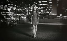 Pretty woman walking around the night city Royalty Free Stock Photography