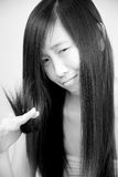 Black and white portrait of sad Asian girl with ruined hair Royalty Free Stock Photo