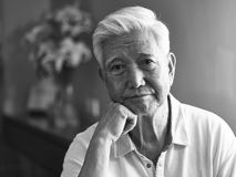 Black and white portrait sad asian senior man Stock Images