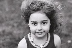 Black and white Portrait of cute little girl smiling outside Royalty Free Stock Images