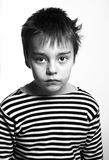 Black-and-white portrait of  serious sad boy. In  striped  vest Royalty Free Stock Photography