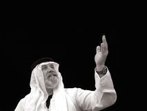 Black and White Portrait - The Sheik Gestures. The Sheik Gestures Toward the Heavens Stock Photo