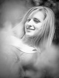 Black and white portrait of smiling blonde woman Royalty Free Stock Image