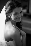 Black and white portrait of smiling brunette bride with long whi Royalty Free Stock Images