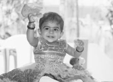A black and white portrait of a smiling cute Indian child girl royalty free stock photography