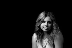Black and white portrait of smiling young woman. Royalty Free Stock Photography