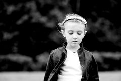 Black and white portrait of thoughtful child girl. Black and white outdoors portrait of thoughtful child girl Royalty Free Stock Photography