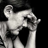 Black and white portrait of a very sad old woman Stock Image