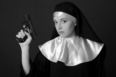 Black and white portrait of woman nun with gun Royalty Free Stock Photo