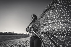 Black and white portrait of woman in scarf at windy day on beach Royalty Free Stock Photo