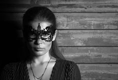 Black and white portrait portrait of young beautiful lady in elegant masquerade mask. Black and white portrait of young beautiful lady in elegant masquerade mask Stock Photos