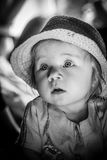 Black and white portrait of a young child. A cute baby. A cute baby. Sunlight on the child`s face. A curious look of a little girl. Sad look of the child. He Stock Images