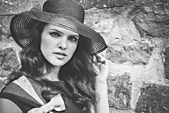 Black-white portrait of young lady in hat Stock Photos