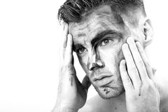 Black and white portrait of a young man with streaks of paint on face . fantasy art of makeup Stock Photos
