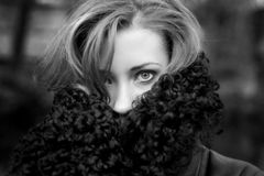 Black and white portrait of young woman. Black and white outdoor portrait of young woman with with anxious eyes Stock Images