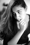 Black and white portrait of young woman thinking Royalty Free Stock Photos